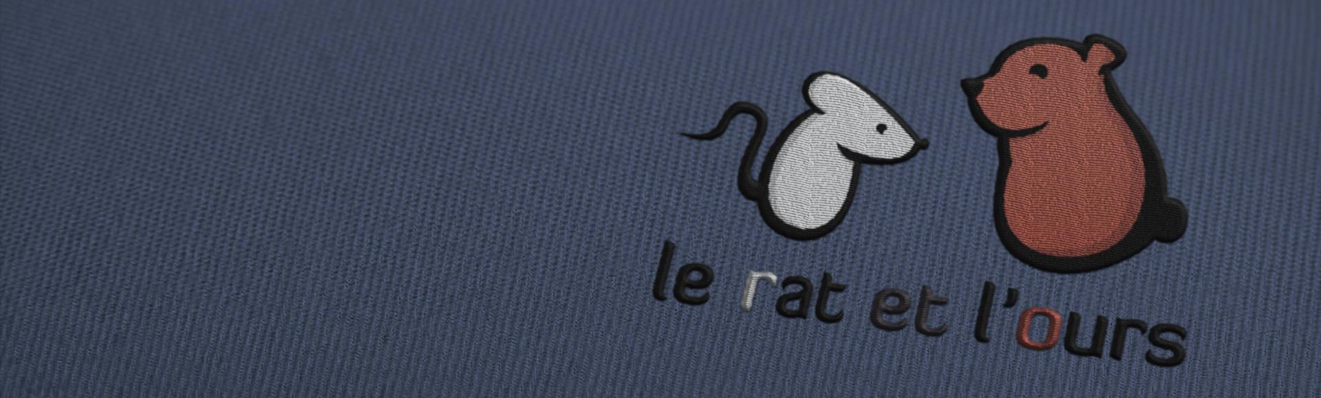 Logo le rat et l'ours graphiste en broderie fait-main (handmade)